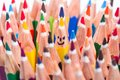 Colorful pencil as smiling faces people image concept for social networking communication concept rise from the crowd Stock Photo