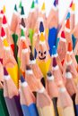 Colorful pencil as smiling faces people image concept for social networking communication concept rise from the crowd Stock Images