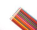 Colorful pencil crayons on the background fabric Royalty Free Stock Images