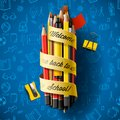 Colorful pencil crayons with text Back to school on ribbon, vector illustration