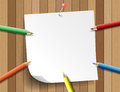 Colorful pencil with paper note on wooden background