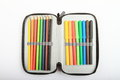 Colorful pencils as rainbow in pencil case on white background Stock Photo