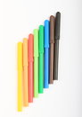 Colorful pencils as rainbow on white background Stock Images