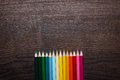 Colorful pencils on the brown wooden table background Royalty Free Stock Image