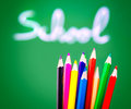 Colorful pencils on chalkboard background green soft focus of handwriting word lesson of art back to school concept Royalty Free Stock Images