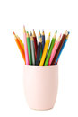 Colorful pencils in cup isolated on a white Royalty Free Stock Photo