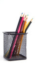 Colorful pencils in a holder on white Stock Images