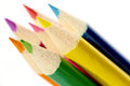 Colorful pencils seven on a white background pointing at the same direction Stock Photography