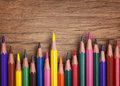 Colorful pencils on a wooden background Stock Photos