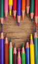 Colorful pencils on a wooden background Royalty Free Stock Photos