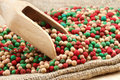 Colorful peppercorns mix, wooden scoop Royalty Free Stock Photography