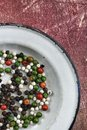 Colorful peppercorns spice black red green and white Stock Images