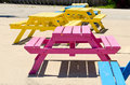 Colorful picnic tables yellow pink blue Royalty Free Stock Photos