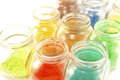 Colorful pigments in open glass jars Royalty Free Stock Image