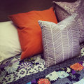 Colorful pillows on a bed close up of with Stock Images