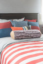 Colorful pillows on bed in single bedroom