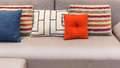 Colorful pillows and cushion on a modern style fabric sofa Stock Image