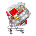 Colorful pills in shopping cart isolated on white concept background Royalty Free Stock Photography