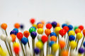 Colorful pin heads close up shot of tops are standing Royalty Free Stock Photography