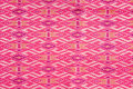 Colorful pink Thai silk fabric texture Stock Photo