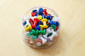 Colorful pins in a box on table Royalty Free Stock Photography