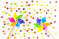 Colorful pinwheels and candies on white background. Top view. Flat lay Royalty Free Stock Photo
