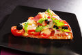 Colorful pizza piece. Royalty Free Stock Photo
