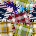Colorful plaids seamless pattern. Vector textured tartan patchworks background. Striped materials. Geometric abstract repeat