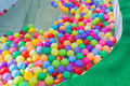 Colorful plastic ball floating on water in the pool for games Royalty Free Stock Photo