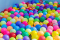 Colorful plastic ball floating on water in the pool for games Stock Image