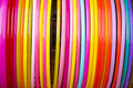 Colorful plastic bangle hanging in the row Royalty Free Stock Photo