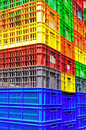 Colorful plastic containers neatly piled Royalty Free Stock Image