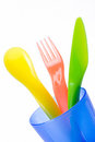Colorful plastic cutlery in cup Royalty Free Stock Image