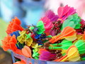 Colorful plastic darts in basket for playing in typical dart game in vintage retro street festival in thailand throwing at ballons Stock Image