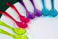Colorful plastic spoons Stock Photography