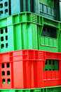 Colorful plastic stacked packing containers Stock Photo