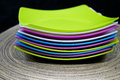 Colorful plastic tableware black background Stock Image