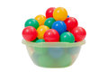 Colorful plastic toy balls into green washbowl isolated on white Royalty Free Stock Photo
