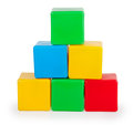 Colorful plastic toy blocks isolated on white background Stock Photos