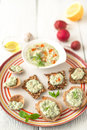 Colorful plate with different bread with tzatziki on the white table Royalty Free Stock Photo