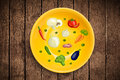 Colorful plate with hand drawn icons symbols vegetables and fr fruits on grungy background Royalty Free Stock Photography