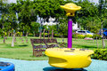 Colorful playground equipment in public park old Stock Photography
