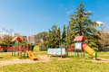 Colorful playground for kids inside a urban public park, Italy Royalty Free Stock Photo