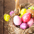 Colorful polka dot eggs in basket easter decorations Stock Photo