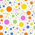Colorful polka dots pattern on white background. Royalty Free Stock Photo