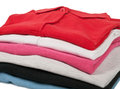 Colorful polo t shirts stack of man s and woman s Royalty Free Stock Photo