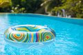 Colorful pool float in blue swimming basin Royalty Free Stock Photo