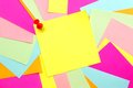 Colorful post it note background blank yellow with thumb tack and scattered Stock Image