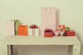 Colorful present boxes, bags and hearts for valentines day Royalty Free Stock Photo