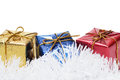 Colorful present boxes on tinsel Royalty Free Stock Image